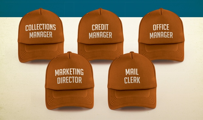Display of hats with different job titles on them