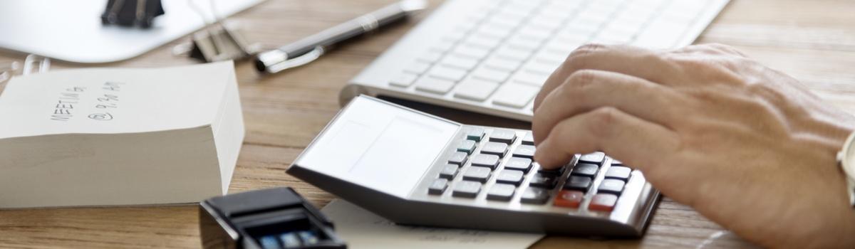 Man-Using-Calculator.jpg