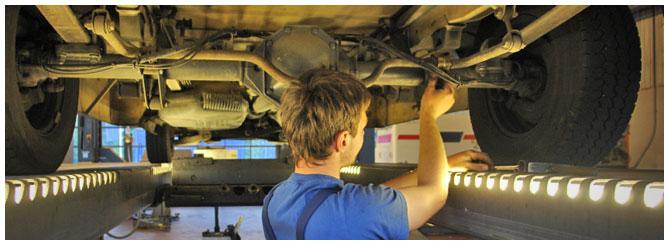 Mechanic working on diesel truck