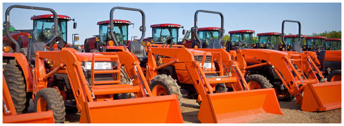 Row of orange tractors