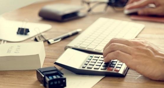 Keyboard and Adding Machine on Desk